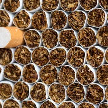 Heap of Tobacco Cigarettes Front View close up Stack background texture