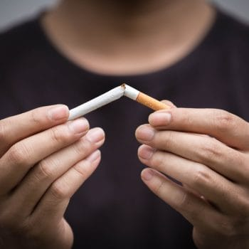 young man crushing cigarette.concept for breaking and quit cigarette for health