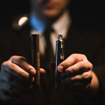 Bad habits. Cigar vs e-cigarette. Man has a choice between traditional and modern way of smoking. Healthy alternative to tobacco