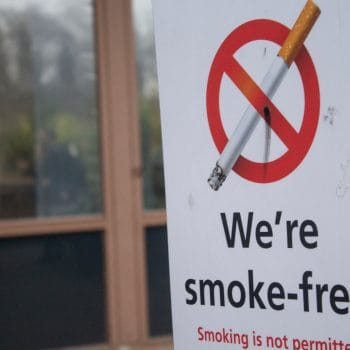 "A sign saying ""We're smoke-free"" outside St Thomas' Hospital"